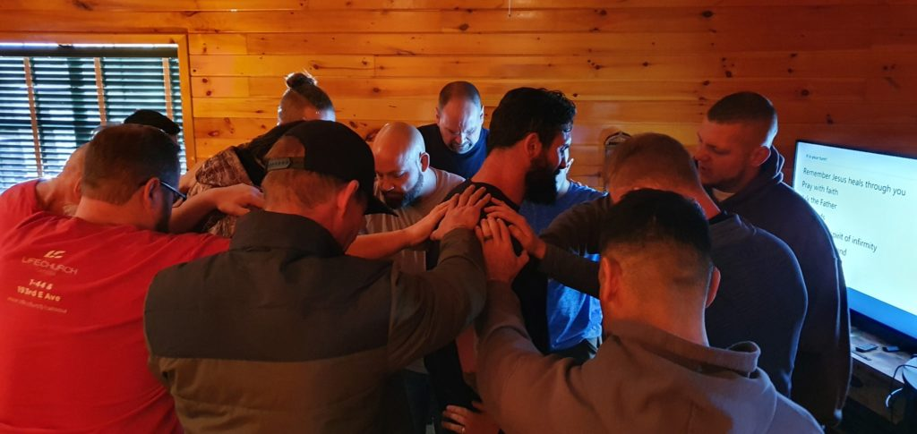 Band of Brothers praying